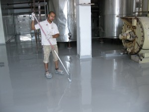 Working with a spike roller on epoxy floors