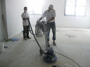Prepare the surface with a suitable surface preparation floor grinder