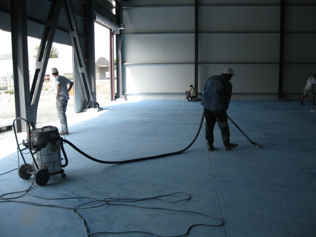 vacuuming concrete floor