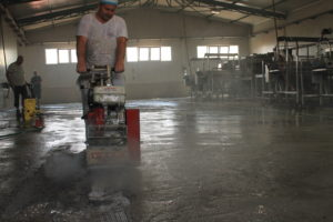 scarifying concrete floor before epoxy coating